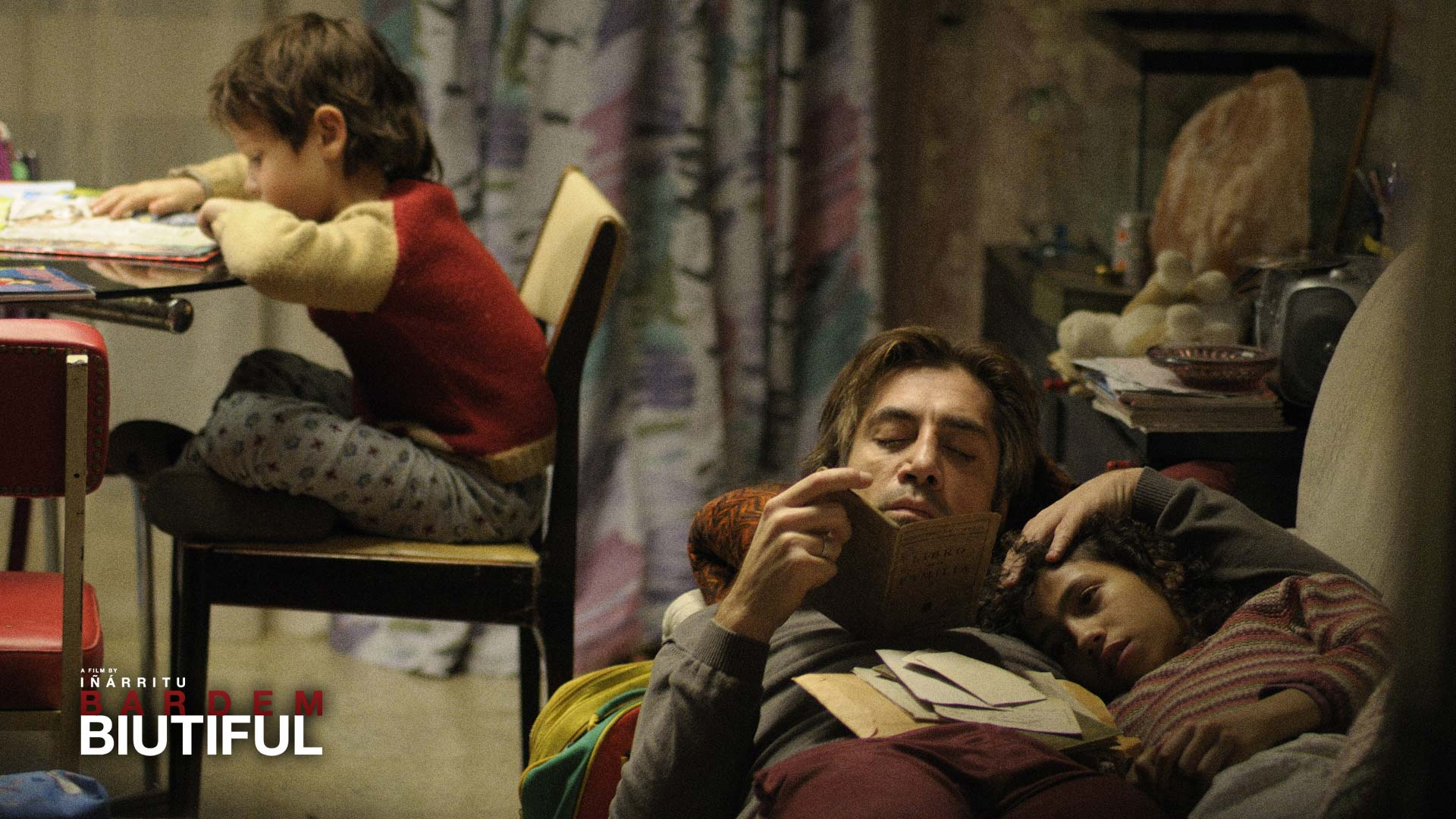 Javier Bardem keeps close to his children in the movie Biutiful, played by young actors Hanaa Bouchaib and Guillermo Estrella, in this wallpaper image